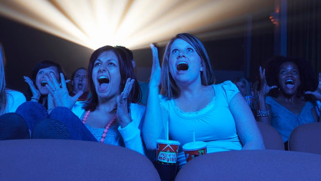 Audience Screaming in Movie Theater