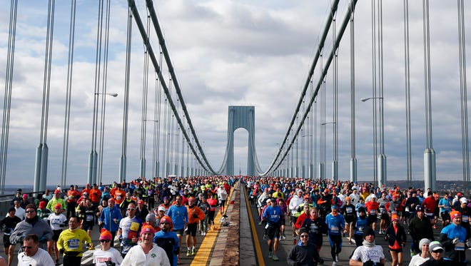 Runners cross the Verrazano-Narrows Bridge at the start of the New York City Marathon, Sunday, Nov. 2, 2014, in New York.