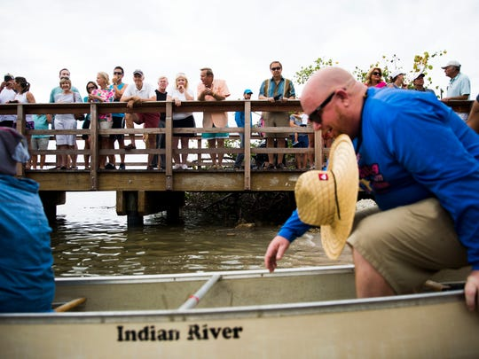 File: Spectators watch as Tippycanoe VIP Sprint participants get into their canoes during the 42nd Annual Great Dock Canoe Race on Saturday, May 12, 2018 at Crayton Cove.