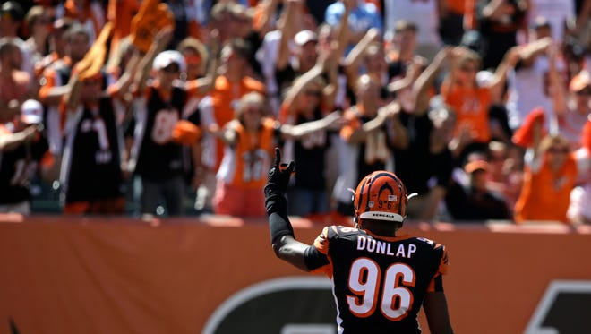 Cincinnati Bengals defensive end Carlos Dunlap urges on the crowd in the second half of an NFL football game against the Tennessee Titans, Sunday, Sept. 21, 2014, in Cincinnati. (AP Photo/Darron Cummings) ORG XMIT: PBS101