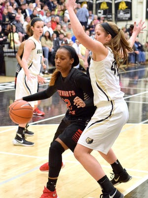 Stewarts Creek's Jasmine Smith (12) tries to get inside the defense of Bradley's Kailey McRee (42).  The Stewarts Creek Lady Red Hawks visited the Bradley Central Bearettes in TSSAA AAA state sectional basketball action in Cleveland, Tn. on March 5, 2016.