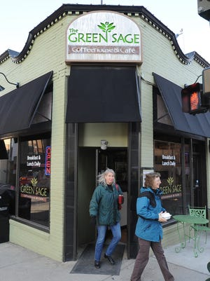 Lisa Gatens and Mary Frazer at the Green Sage Coffeehouse in downtown Asheville in 2010.