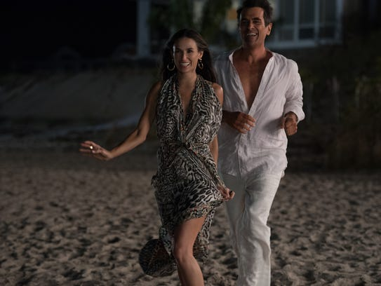 Lea (Demi Moore) and Pietro (Ty Burrell) like to swing