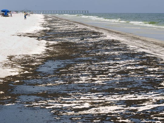 Oil mats were abundant along Pensacola Beach in June 2010 after the Deepwater Horizon oil spill. Five years later, the coast is not clear when it comes to oil spill impacts.