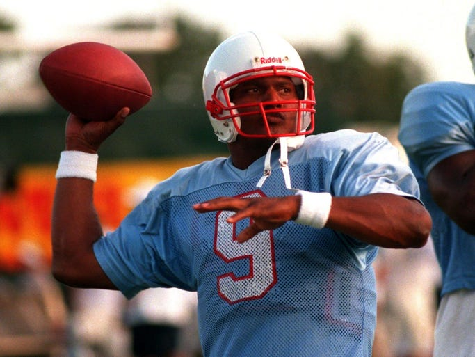 Houston Oilers quarterback Steve McNair warming up before a scrimmage.