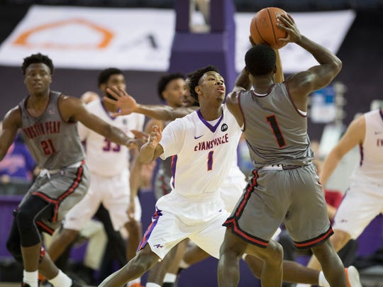 Evansville's Marty Hill (1) pressures Austin Peay's Tre' Ivory (1) during the first half at the Ford Center Saturday afternoon. The Purple Aces beat the Governors 78-74 in overtime to improve to 9-2 on the season.