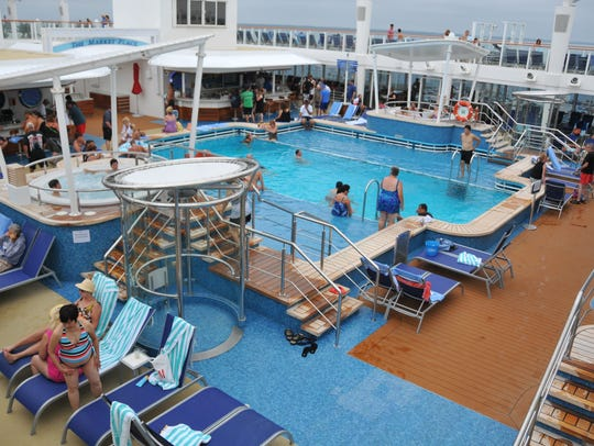 Passengers enjoy one of the pool areas aboard the Norwegian