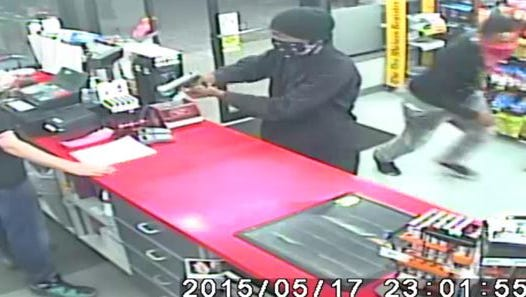 Video surveillance captures an armed robbery at the Git-N-Go in the 4200 block of Northwest 2nd Avenue in Polk County.