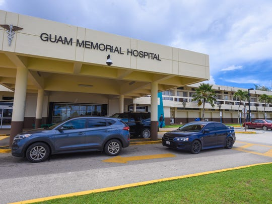 In this July 7, 2017, file photo, drivers wait near the entrance of the Guam Memorial Hospital.