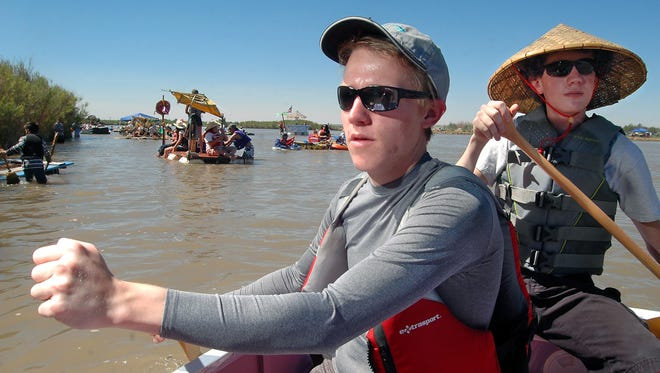 Josh Cook, left, and Isaac Hartman, paddle their boat down the Rio Grande in 2011 during Raft the Rio.