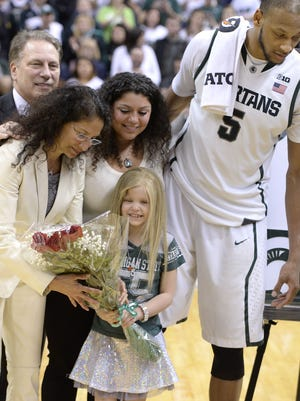Tom Izzo, back left, and his wife Lupe and daughter Raquel stand with Lacey Holsworth during the senior day celebration for Adreian Payne (5) on March 6, 2014.