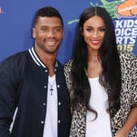 Seattle Seahawks quarterback Russell Wilson, left, and singer Ciara arrive at the 2015 Kids' Choice Sports Awards in Los Angeles. A representative for Ciara confirms that the couple are engaged. Russell posted a video on his Facebook page Friday, March 11, 2016, showing himself next to Ciara, who was wearing a bright ring.