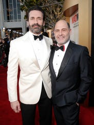 Jon Hamm, left, and Matthew Weiner celebrate the final