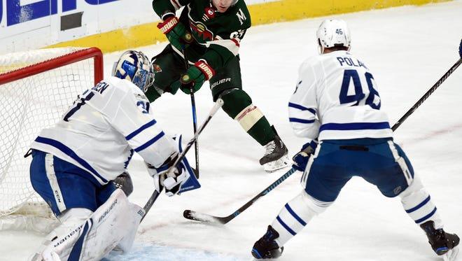 Minnesota Wild left wing Tyler Ennis (63) shoots against Toronto Maple Leafs goalie Frederik Andersen (31), of Denmark, and defenseman Roman Polak (46), of the Czech Republic, during the second period of an NHL hockey game Thursday, Dec. 14, 2017, in St. Paul, Minn. (AP Photo/Hannah Foslien)