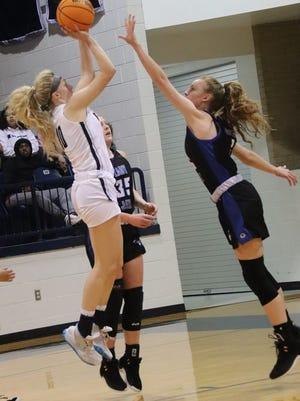 Shawnee's Aubrie Megehee launches a shot over a Guthrie defender Tuesday night.