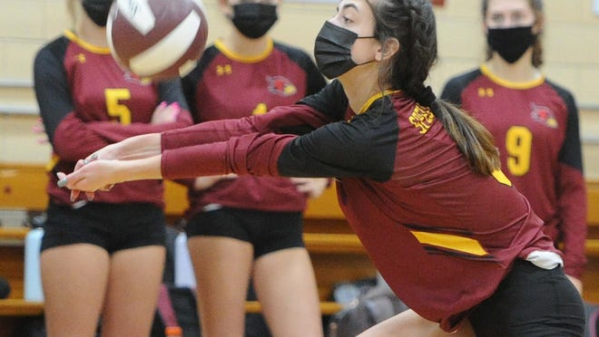 Cardinal Spellman's Julia Schmitchel sets the volleyball during their game versus Arlington Catholic on Thursday, Nov. 5, 2020.
