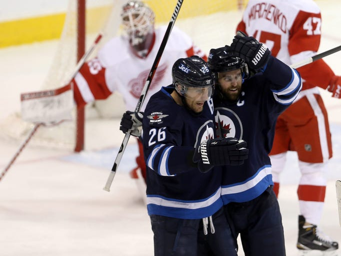 Winnipeg Jets' Blake Wheeler (26) and Andrew Ladd celebrate