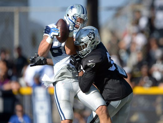 Dallas Cowboys tight end Dallas Walker (86) is defended by Oakland Raiders cornerback Keith McGill (39) at scrimmage against the Dallas Cowboys at River Ridge Fields.