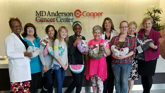 """Members of the sewing club at Cumberland Christian School visited M.D. Anderson at Cooper Medical Center on April 17. During their visit, they distributed breast cancer pillows they created in their sewing class and also witnessed and prayed with patients. Also, the staff at M.D. Anderson Cancer Institute provided a lecture, """"Cancer 101,"""" and a tour of the facility. The visit concluded with lunch."""
