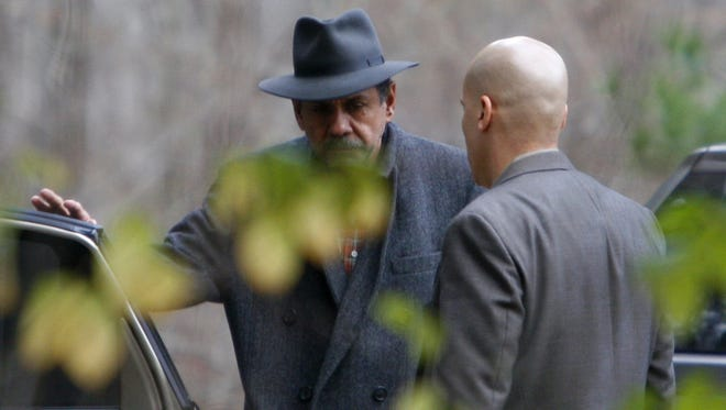 Carlos Perez-Olivo, left, with a New Castle detective at his Chappaqua home Nov. 21, 2006.