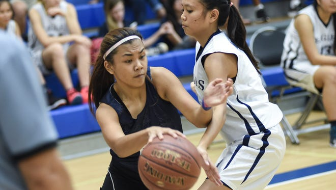 The Tiyan Lady Titans played  the Harvest Christian Academy Eagles in an Independent Interscholastic Athletic Association of Guam Girls' Basketball League match at Harvest on Nov. 12.