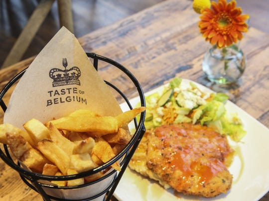 Taste of Belgium's signature dish: a Belgian waffle and chicken with a side of frites.