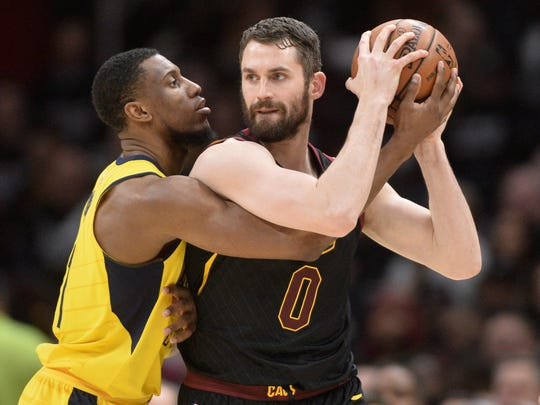 Indiana Pacers forward Thaddeus Young (21) defends Cleveland Cavaliers center Kevin Love (0) during the first half in game seven of the first round of the 2018 NBA Playoffs at Quicken Loans Arena.