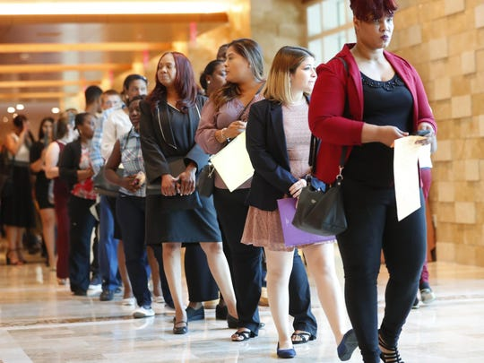 In this Tuesday, June 4, 2019 photo, job applicants line up at the Seminole Hard Rock Hotel & Casino Hollywood during a job fair in Hollywood, Fla. On Friday, July 5, the U.S. government issues the June jobs report. (AP Photo/Wilfredo Lee)