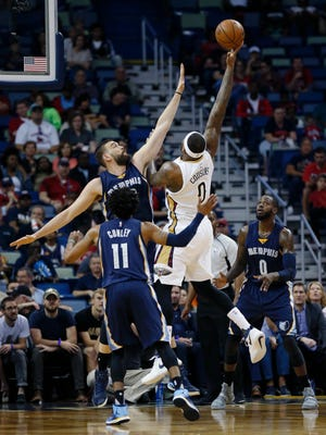 New Orleans Pelicans forward DeMarcus Cousins (0) shoots against Memphis Grizzlies center Marc Gasol in the first half of an NBA basketball game in New Orleans, Tuesday, March 21, 2017. (AP Photo/Gerald Herbert)