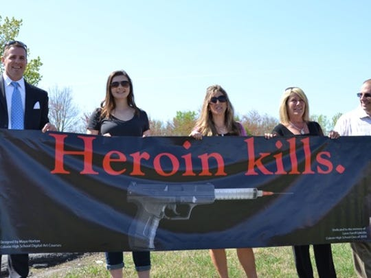 In Albany, New York, high school student Maya Horton, second from left, won a design for a heroin billboard contest. York County is sponsoring a similar contest this month.
