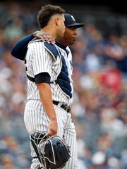 New York Yankees relief pitcher Aroldis Chapman (54) and Yankees catcher Gary Sanchez (24) look on during a break in action against the Tampa Bay Rays during the ninth inning at Yankee Stadium on Saturday, July 29, 2017.