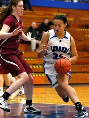 St. Mary's Springs' Anja Smith drives to the basket