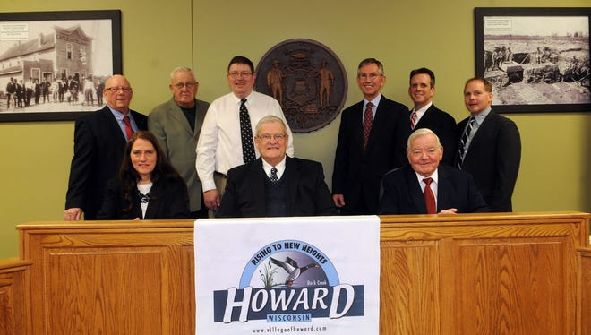 The Village of Howard board in 2013. In the back row, John Havey is second from the left, Jim Widiger is third from the left and David Steffen is second from the right.