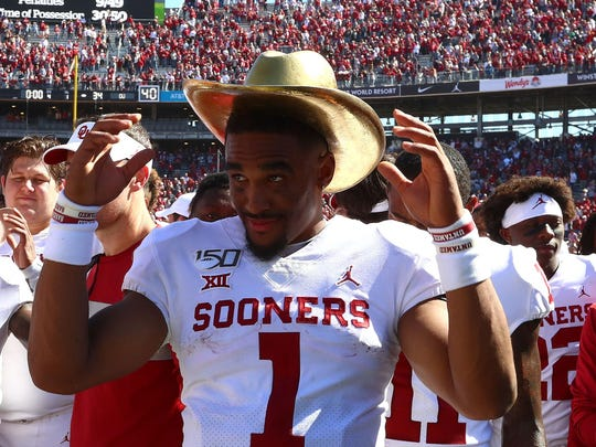 Oct 12, 2019; Dallas, TX, USA; Oklahoma Sooners quarterback Jalen Hurts (1) wears the Golden Hat trophy after a victory against the Texas Longhorns at Cotton Bowl. Mandatory Credit: Matthew Emmons-USA TODAY Sports