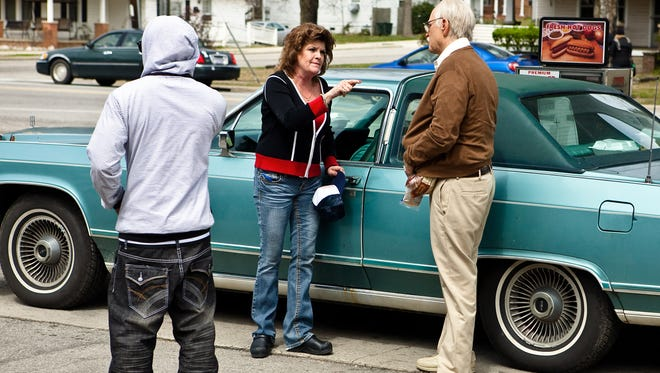 Johnny Knoxville, right, is Irving Zisman in Jackass  Presents: Bad Grandpa, shown here with his 1981 Lincoln