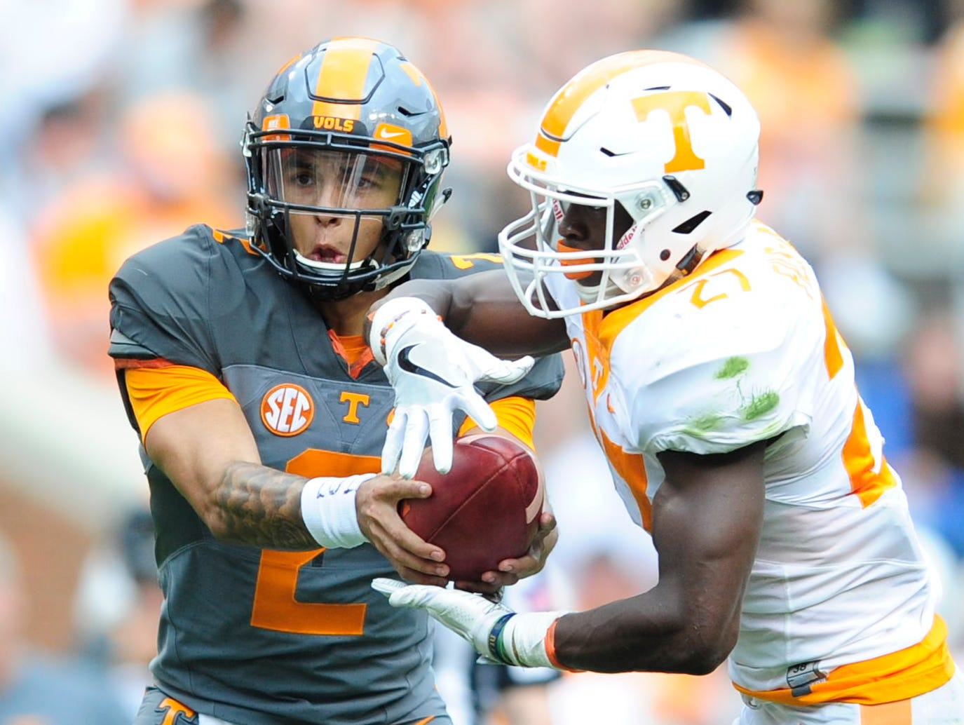 University of Tennessee's quarterback Jarrett Guarantano (2) hands the ball off to University of Tennessee's running back Carlin Fils-aime (27) during the Orange & White Game at Neyland Stadium in Knoxville, Tennessee on Saturday, April 22, 2017.
