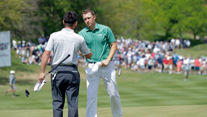 Jordan Spieth shakes hands after losing to Louis Oosthuizen of South Africa on the 16th hole in round 4 of the World Golf Championship-Dell Match Play at the Austin Country Club.