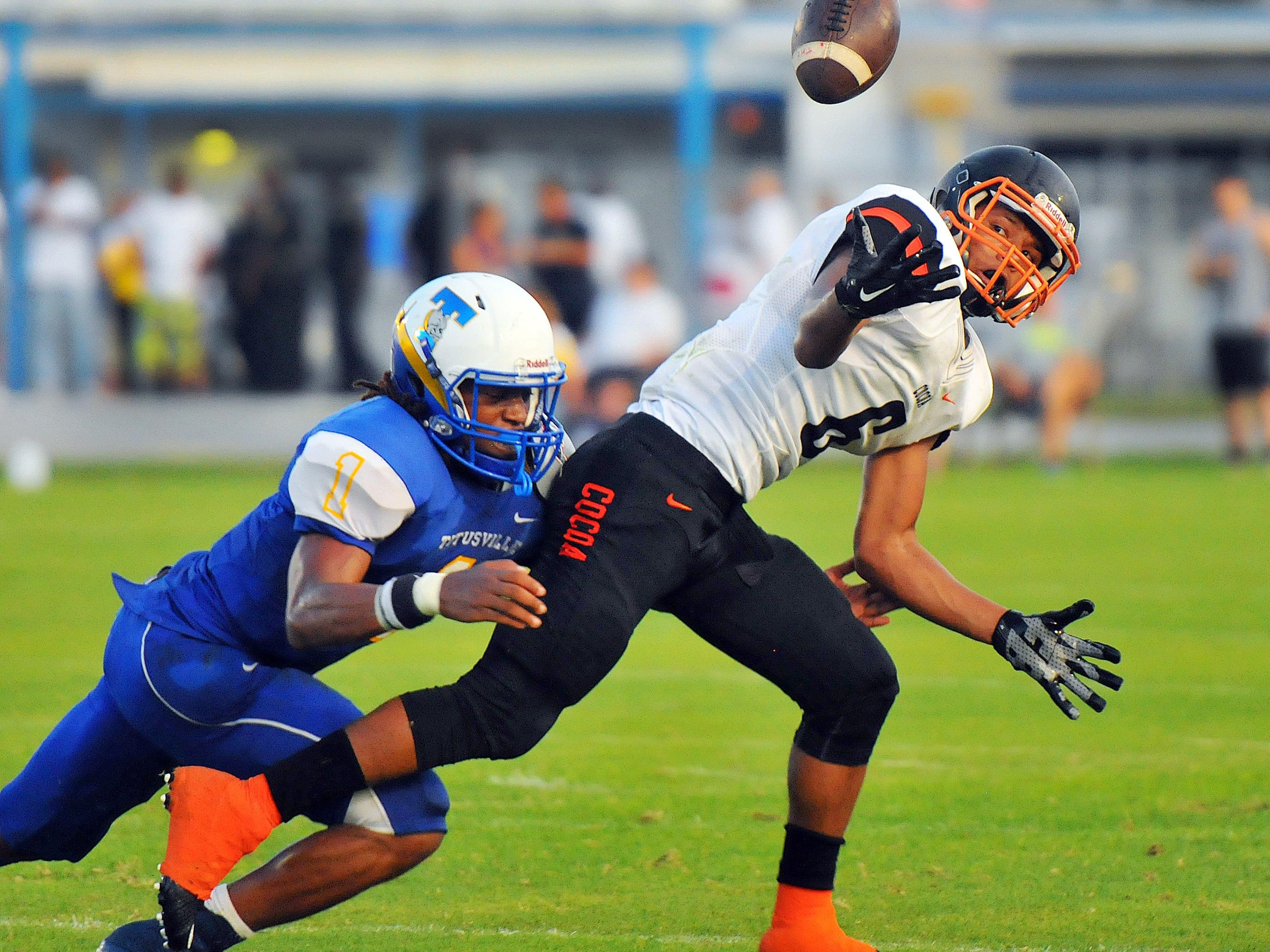 Cocoa High's John Smith (6) comes up with a fumble recovery after a hit on Titusville High quarterback Yusuf DeReese.