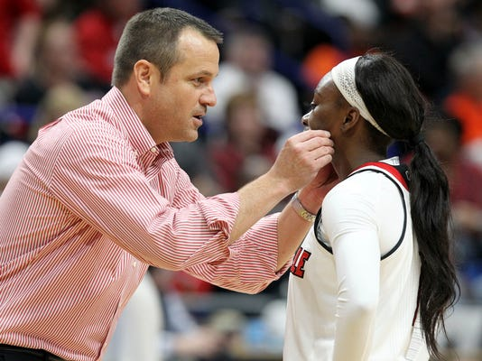 Louisville's head coach Jeff Walz instructs Dana Evans during the second half of an NCAA women's college basketball tournament regional final against Oregon State, Sunday, March 25, 2018, in Lexington, Ky. Louisville won 76-43.(AP Photo/James Crisp)