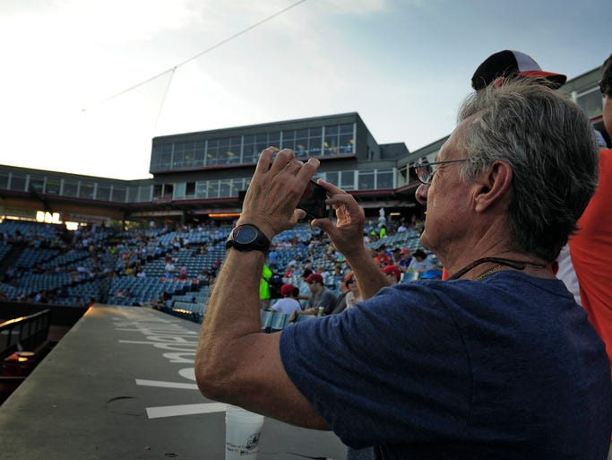 Sounds fans Jack Elisar takes a few pictures Greer Stadium before the start of the last game to be played at the ball park Wednesday Aug. 27, 2014, in Nashville, Tenn.