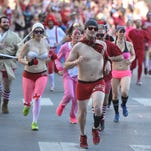 Runners race down 2nd Avenue in 30 degree weather for Cupid's Undie Run on Saturday, February 13, 2016.