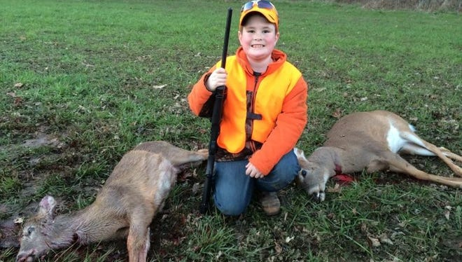 Cash Koch, 7, of Houston, Mo., bagged two deer with one shot during his first deer hunt.