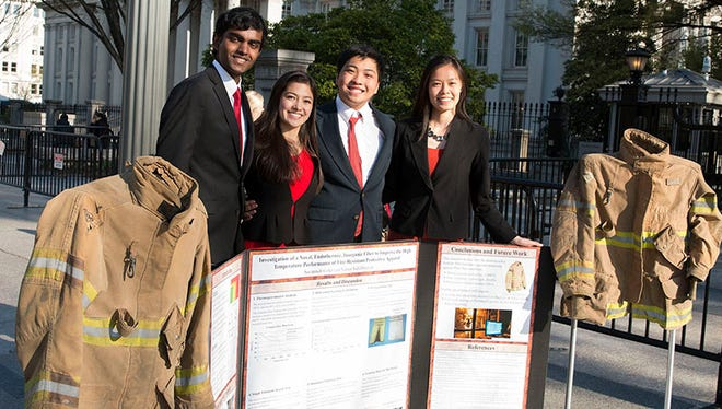The inventors of Fire Armor with their work outside the White House are, from left, Varun Vallabhaneni, 17, Savannah Cofer, 18, Matthew Sun, 17, and Valerie Chen, 18.