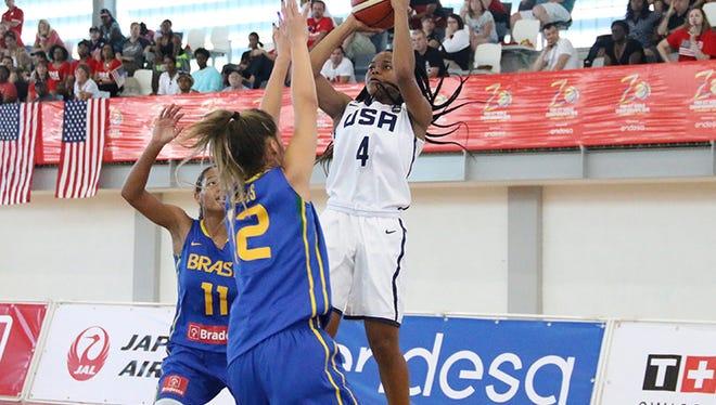 USA U17 women's basketball guard and Fort Myers rising senior Destanni Henderson goes up for a shot against Brazil on Monday, June 27 in Zaragoza, Spain.