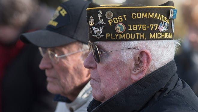 World War II veterans Gene Overholt and Charles Minthorn stand for the opening prayer.