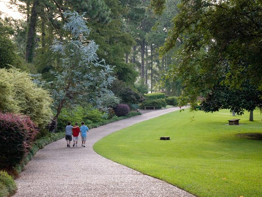 Boys walk through the gardens at Hodges Gardens State