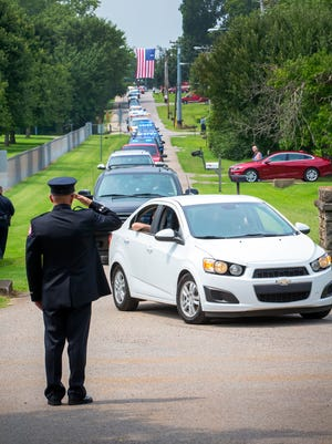 "A long processional of cars and emergency vehicles flooded Mapleview Cemetery in Smyrna on Aug. 22, 2018, for the funeral of La Vergne Fire Chief Richard ""Rick"" McCormick."