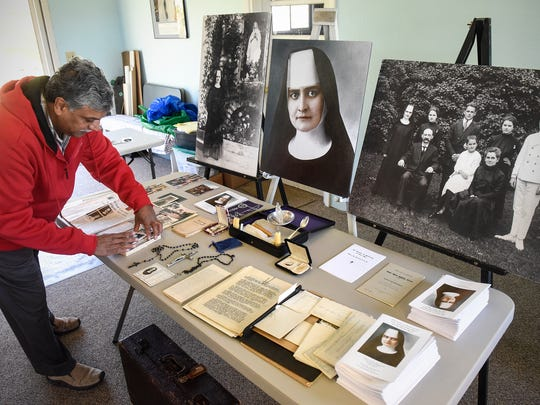 Patrick Norton explains details of a collection of items relating to Sister M. Annella Zervas Tuesday, Oct. 24, at his home in St. Joseph.