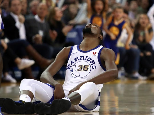 Golden State Warriors' Kevin Durant looks up from the floor after a foul was called in his favor during the second half of the team's NBA basketball game against the Charlotte Hornets on Friday, Dec. 29, 2017, in Oakland, Calif. Charlotte won 111-100. (AP Photo/Ben Margot)