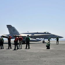 A Navy FA-18 preparing for a raid on IS targets in Iraq in August. (Photo: MC2 Joshua Horton, U.S. Navy)
